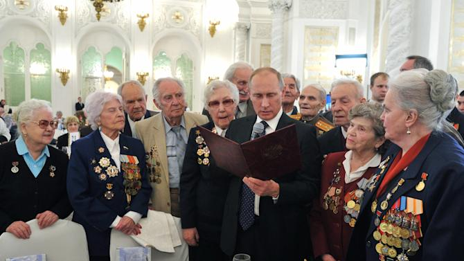 In this photo made Friday, Feb. 1, 2013, Russian President Vladimir Putin, center, meets with World War II veterans at a reception marking the 70th anniversary of the Battle of Stalingrad, in the Kremlin in Moscow, Russia. The Battle of Stalingrad was turning point in World War II that led to the defeat of the Nazi Germany. (AP Photo/RIA-Novosti, Alexei Nikolsky, Presidential Press Service)