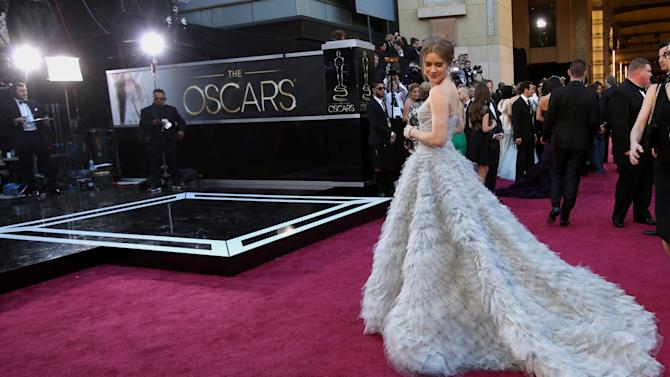 Actress Amy Adams arrives at the Oscars at the Dolby Theatre on Sunday Feb. 24, 2013, in Los Angeles. (Photo by Carlo Allegri/Invision/AP)