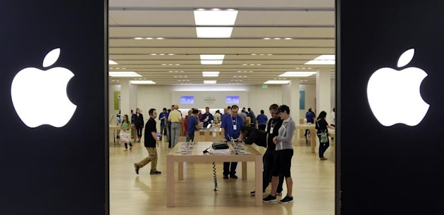 In this Friday, Oct, 26, 2012, photo, people shop at an Apple store inside a mall in Cheektowaga, N.Y. Americans spent briskly in October before Superstorm Sandy hit the Northeast, but the question is whether theyre still willing to get an iPhone for Christmas if they plunked down hundreds on a generator for Sandy. The storm, which hit at the East Coast at the tail-end of October, did not appear to negatively impact sales during the month. (AP Photo/David Duprey)