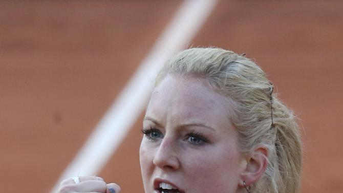 Poland's Urszula Radwanska clenches her fist when scoring a point against Venus Williams of the U.S. in their first round match of the French Open tennis tournament, at Roland Garros stadium in Paris, Sunday, May 26, 2013. (AP Photo/Michel Euler)