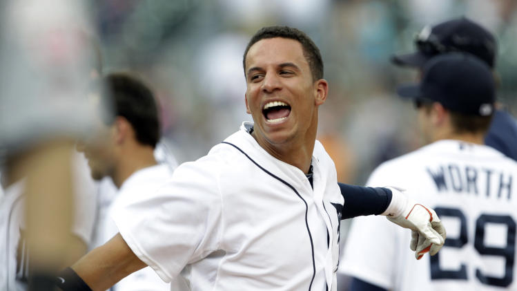 Detroit Tigers' Quintin Berry celebrates hitting an RBI single against the St. Louis Cardinals in the 10th inning of a baseball game in Detroit, Thursday, June 21, 2012. Detroit won 2-1. (AP Photo/Paul Sancya)