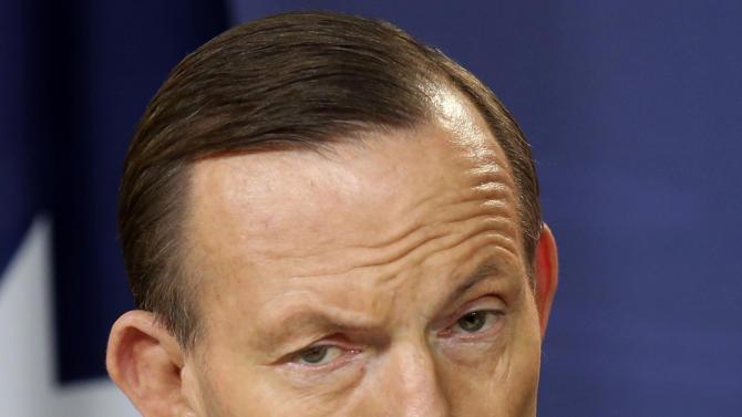 FILE - In this July 19, 2014 file photo, Australia's Prime Minister Tony Abbott speaks during a press conference in Sydney, Australia. Abbott said Wednesday, July 30, 2014 that he is not considering ratcheting up sanctions against Russia while his government focuses on retrieving Australian victims from the wreckage of the Malaysian airliner disaster in Ukraine. (AP Photo/Rob Griffit, File)