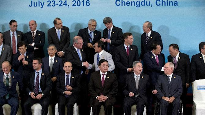 G20 Finance Ministers and Central Bank Governors prepare for a group photo session in Chengdu in Southwestern China's Sichuan province, Sunday, July 24, 2016. Finance Ministers and Central Bank Governors of the 20 most developed economies met in the southwestern city of Chengdu ahead of a G20 leaders meeting in September hosted by China. Participants in the front row are, from left are: World Bank President Jim Yong Kim, an unidentified member, Turkey's Deputy Prime Minister Mehmet Simsek, China's Finance Minister Lou Jiwei, China's People's Bank of China Governor Zhou Xiaochuan and Germany's Federal Minister of Finance Wolfgang Schauble. (AP Photo/Ng Han Guan, Pool)