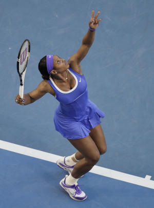 Serena Williams of the US serves to Hungary's Greta Arn during their third round match at the Australian Open tennis championship, in Melbourne, Australia, Saturday, Jan. 21, 2012. (AP Photo/John Donegan)