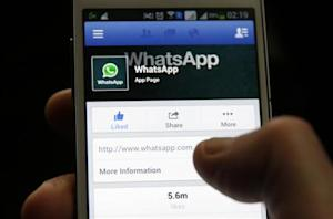 A Whatsapp App page is seen on Facebook on a Samsung Galaxy S4 phone in the central Bosnian town of Zenica, February 20, 2014. REUTERS/Dado Ruvic