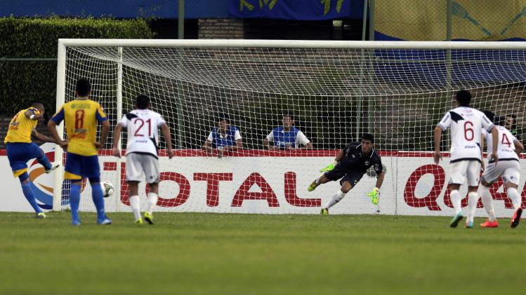 Escobar of Deportivo Capiata scores a second penalty past goalkeeper Ichazo of Danubio during their Copa Sudamericana soccer match in Luque