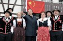 Chinese Prime Minister Li Keqiang poses together with the Swiss yodel group ''Saengerrunde Zurich'' in Embrach, Switzerland, Friday, May 24, 2013. Li Keqiang is on an official visit to Switzerland until Saturday. (AP Photo/Keystone,Walter Bieri )