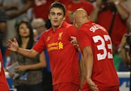 TORONTO, CANADA - JULY 21: Adam Morgan #50 of Liverpool is congratulated by Jonjo Shelvey #3 after scoring against Toronto FC during the World Football Challenge friendly match on July 21, 2012 at Rogers Centre in Toronto, Ontario, Canada. (Photo by Tom Szczerbowski/Getty Images)