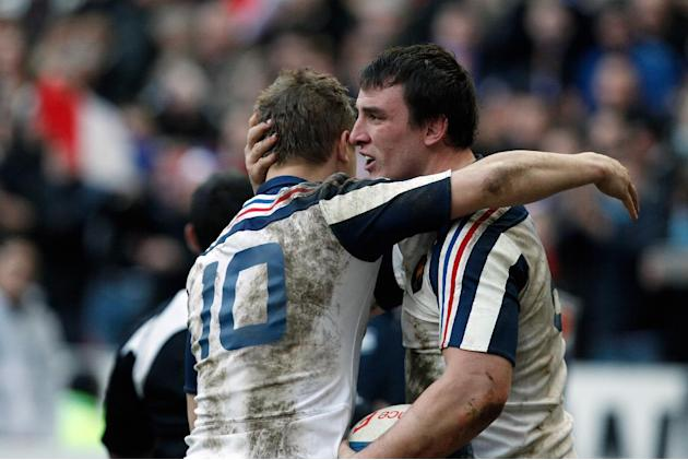 France's Louis Picamoles, right, is congratulated by teammate Jules Plisson, after he scored a try during their Six Nations rugby union international match against Italy, at the Stade de France, i