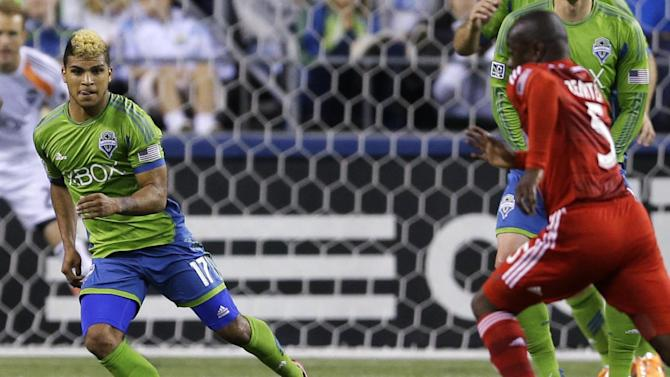 In a May 7, 2014 photo Seattle Sounders' DeAndre Yedlin,  left, eyes the ball  in the first half of an MLS soccer match against FC Dallas in Seattle. U.S. team coach Jurgen Klinsman named  Yedlin to the team's 30-man preliminary roster on Monday May 12, 2014