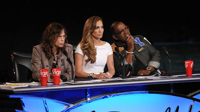 "FILE - In this file image released by Fox, judges from left, Steven Tyler, Jennifer Lopez and Randy Jackson listen to contestants on the singing competition series ""American Idol."" (AP Photo/Fox, Michael Becker, File)"