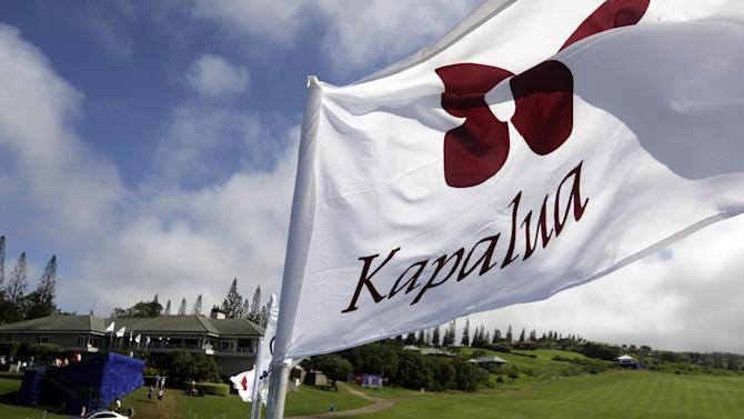 A course flag flutters in view of the empty 19th fairway after play was suspended because of wind during the first round at the Tournament of Champions PGA golf tournament, Sunday, Jan. 6, 2013, in Kapalua, Hawaii. Play was to have started two days earlier, but was delayed because of rain and high winds and Sunday's start included a wind delay after players began play. (AP Photo/Elaine Thompson)