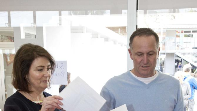 New Zealand's National Party leader John Key casts his vote with his wife Bronagh on election day during New Zealand's general election in Auckland