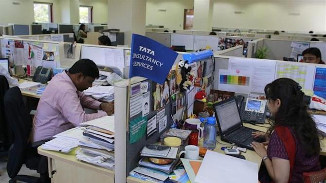 Employees of Tata Consultancy Services (TCS) work inside the company headquarters in Mumbai March 14, 2013. REUTERS/Danish Siddiqui/Files
