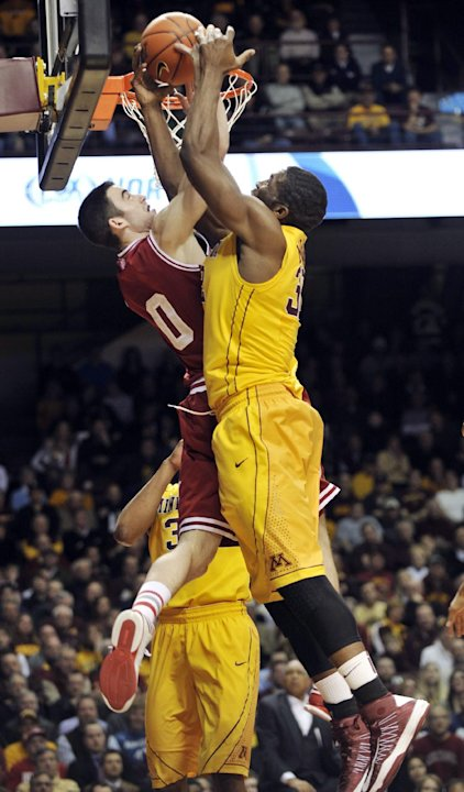 Minnesota's Trevor Mbakwe, right, and Indiana's Cody Zeller, left, battle for a rebound during the first half of an NCAA college basketball game, Tuesday, Feb. 26, 2013, in Minneapolis. (AP Photo/Tom