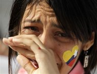 A medical student from Venezuela cries during a tribute in honor of the late President Hugo Chavez at Cuban independence hero Jose Marti's memorial in Havana March 7, 2013. REUTERS/Desmond Boylan