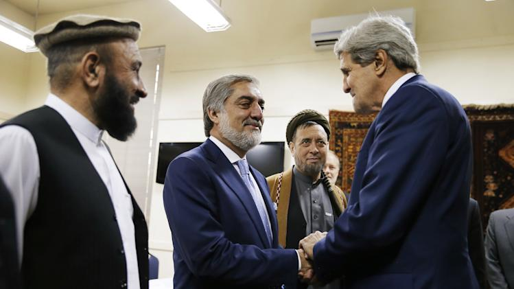 US Secretary of State John Kerry (R) greets Afghanistan presidential candidate Abdullah Abdullah (2L) with his vice-presidential candidates, Mohammad Kahn (L) and Mohammed Mohaquiq (2R) at the US Embassy in Kabul on July 11, 2014