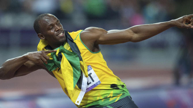 Jamaica's Usain Bolt poses after his win in the men's 200 meters at the Summer Olympics in London on Thursday, Aug. 9, 2012. (AP Photo/The Canadian Press, Sean Kilpatrick)