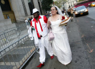 Jeannette Coleman, right, holds back tears as she and Kawane Harris, both of New York, arrive to get married at the Manhattan City Clerk's office, Sunday, July 24, 2011 in New York. (AP Photo/Jason DeCrow)