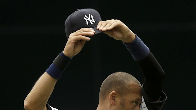 New York Yankees' Derek Jeter wipes sweat from his face before a baseball game against the Kansas City Royals at Yankee Stadium Thursday, July 11, 2013, in New York. (AP Photo/Seth Wenig)