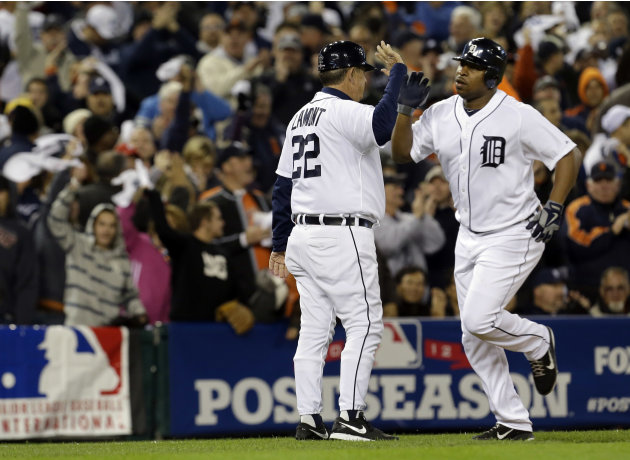Detroit Tigers' Delmon Young is congratulated by third base coach Gene Lamont after hitting a home run in the fourth inning during Game 3 of the American League championship series against the New Yor