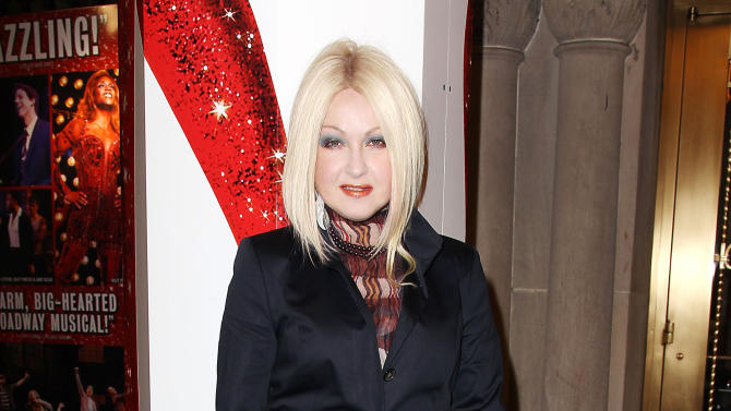 """This Feb. 28, 2013 photo released by Starpix shows, Cyndi Lauper at the open house for the Upcoming Musical """"Kinky Boots,"""" featuring Music by Cyndi Lauper, at the Al Hirshfeld Theatre in New York. The Cyndi Lauper-scored """"Kinky Boots"""" has earned a leading 13 Tony Award nominations, Tuesday, April 30, 2013. """"Kinky Boots"""" is based on the 2005 British movie about a real-life shoe factory that struggles until it finds new life in fetish footwear. Lauper's songs and a story by Harvey Fierstein have made it a crowd-pleaser. (AP Photo/Starpix, Kristina Bumphrey)"""