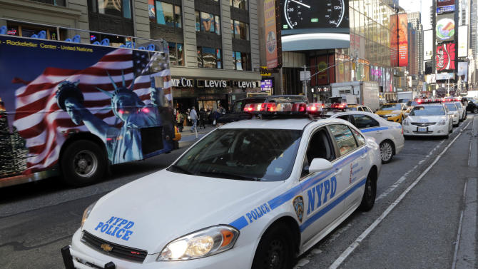 New York City Police officers patrol in New York's Times Square,  Thursday, April 25, 2013. The Boston Marathon bombing suspects had planned to blow up their remaining explosives in New York's Times Square, officials said Thursday. (AP Photo/Richard Drew)