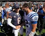 Jay Cutler of the Chicago Bears shakes hands win Andrew Luck (R) of the Indianapolis Colts after their 2012 NFL season opener at Soldier Field in Chicago, Illinois. The Bears defeated the Colts 41-21. Jonathan Daniel/Getty Images/AFP
