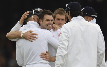 England's Anderson is congratulated by his teammates after dismissing New Zealand's Williamson during the first test cricket match at Lord's cricket ground in London