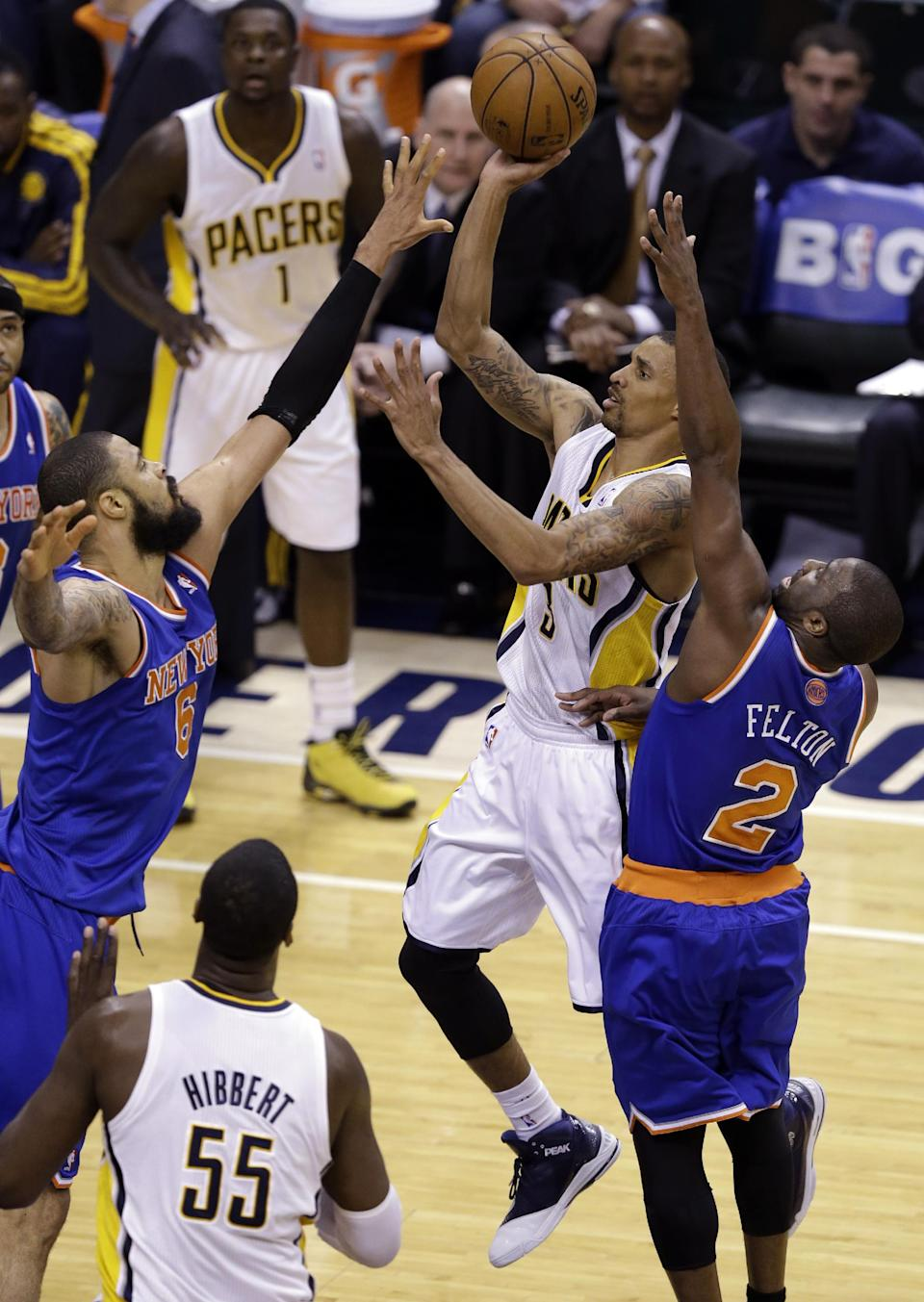 Indiana Pacers guard George Hill shoots between New York Knicks center Tyson Chandler, left, and guard Raymond Felton during the first half of Game 4 of the Eastern Conference semifinal NBA basketball playoff series, in Indianapolis on Tuesday, May 14, 2013. (AP Photo/Michael Conroy)
