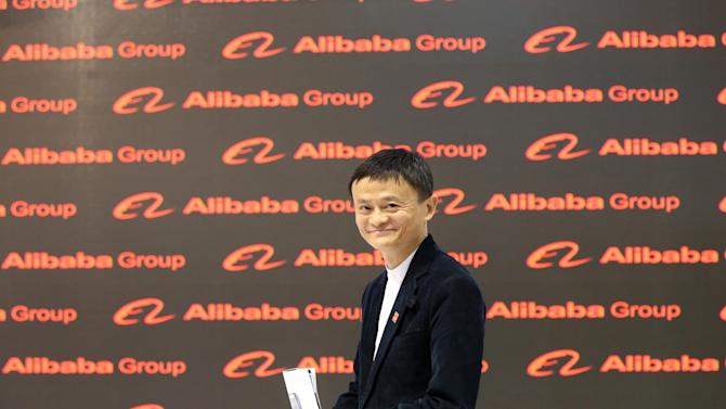 Jack Ma, founder and CEO of the Alibaba Group walks through the Chinese pavilion on the opening day of the Cebit 2015 tech fair in Hannover, northern Germany, Monday, March 16, 2015. China is this year's official partner country. (AP Photo/dpa, Christian Charisius)
