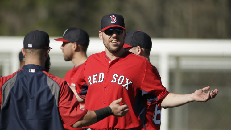 Boston Red Sox starting pitcher John Lackey, center, stretches during spring training baseball practice Monday, Feb. 17, 2014, in Fort Myers, Fla. (AP Photo/Steven Senne)