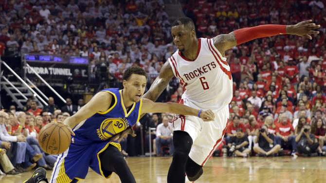 Golden State Warriors guard Stephen Curry (30) is defended by Houston Rockets forward Terrence Jones (6) during the first half in Game 3 of the NBA basketball Western Conference finals Saturday, May 23, 2015, in Houston. (AP Photo/David J. Phillip)
