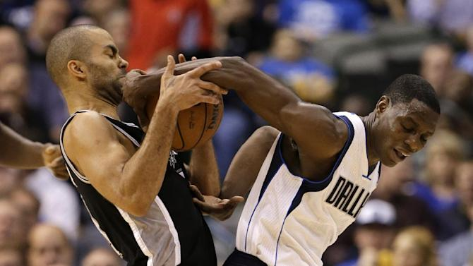 San Antonio Spurs' Tony Parker, left, of France, attempts to steal the ball away from Dallas Mavericks' Darren Collison, right, in the second half of an NBA basketball game on Friday, Jan. 25, 2013, in Dallas. Collison was able to retain control of the ball in the 113-107 Mavericks loss. (AP Photo/Tony Gutierrez)