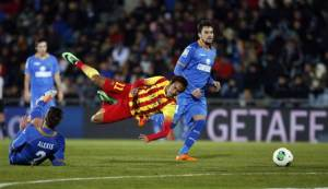 Barcelona's Neymar falls as he is tackled by Getafe's Alexis during their Spanish King's Cup soccer match in Getafe