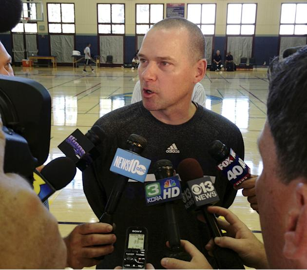Sacramento Kings coach Mike Malone speaks with the media after the first practice of NBA basketball training camp on Tuesday, Oct. 1, 2013, in Santa Barbara, Calif. The Kings are hoping their successf