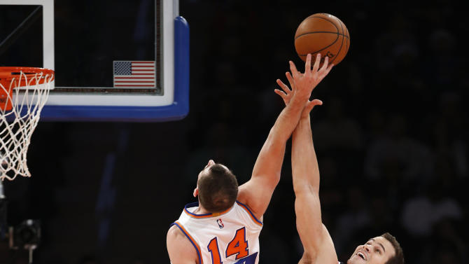 Washington Wizards forward Kris Humphries (43) tips the ball away from New York Knicks center Jason Smith (14) in the first half of an NBA basketball game at Madison Square Garden in New York, Thursday, Dec. 25, 2014. (AP Photo/Kathy Willens)