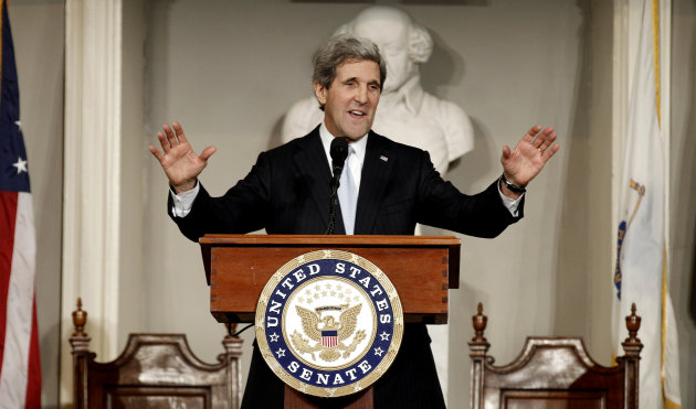 FILE - In this photo Thursday, Jan. 31, 2013, U.S. Sen. John Kerry acknowledges applause while addressing constituents at Faneuil Hall in Boston. New Secretary of State John Kerry reached out to Israeli and Palestinian leaders in phone calls this weekend, assuring them the Obama administration will continue to pursue a Mideast peace agreement while recognizing the individual concerns on both sides. (AP Photo/Winslow Townson, File)