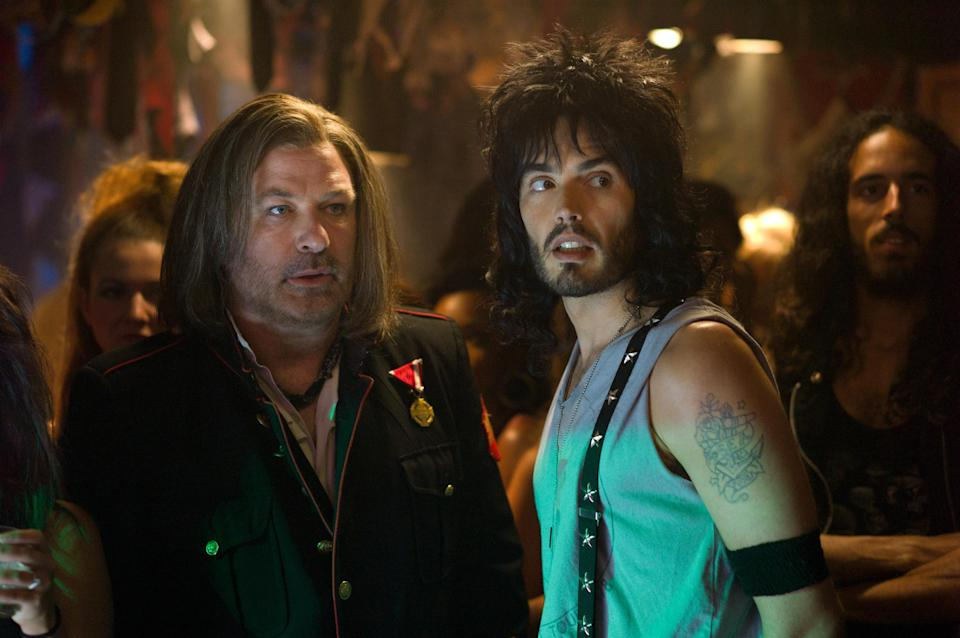 "This film image released by Warner Bros. Pictures shows Alec Baldwin as Dennis Dupree, left, and Russell Brand as Lonny in New Line Cinema's rock musical ""Rock of Ages,"" a Warner Bros. Pictures release. (AP Photo/Warner Bros. Pictures, David James)"