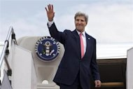 U.S. Secretary of State John Kerry waves as he leaves, after completing his trip to Malaysia, from Subang TUDM outside of Kuala Lumpur, October 11, 2013. REUTERS/Jacquelyn Martin/Pool