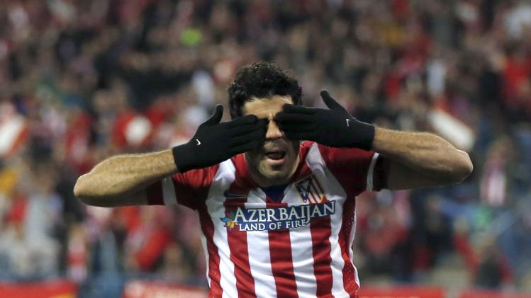 Atletico Madrid's Diego Costa celebrates scoring a goal against AC Milan during their Champions League last 16 second leg soccer match at Vicente Calderon stadium in Madrid