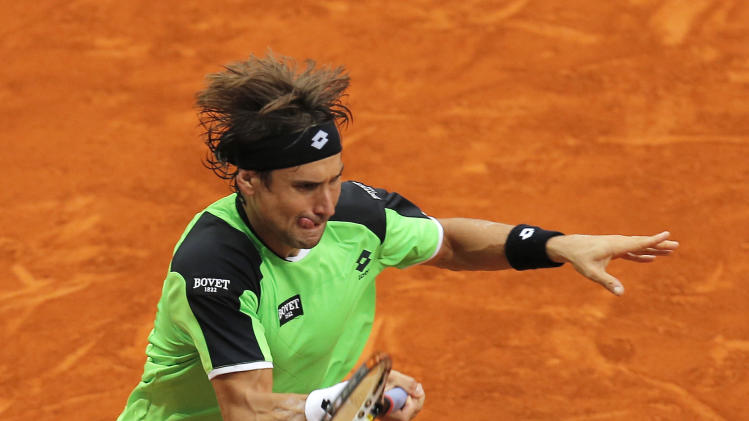 David Ferrer from Spain returns the ball during the match against Tommy Haas from Germany at the Madrid Open tennis tournament, in Madrid, Thursday, May 9, 2013. (AP Photo/Andres Kudacki)