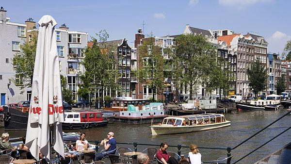 4. Netherlands Highest income tax rate: 52%  Average 2010 income: $57,000   Holland's highest tax rate of 52 percent is much higher than the regional average of 45.7 percent in Western Europe.   The country's top marginal tax rate kicks in at about $74,500 of taxable income. Annual property taxes generally range between $470 and $800. Other notable taxes include a capital gains tax of 25 percent, a land transfer tax of 6 percent and an inheritance tax that varies between 10 percent and 40 percent.   The Netherlands, which has been in recession since July, announced a budget deal in April for 2013 that will freeze the incomes of civil servants for two years to save the government $3 billion by the end of 2013. Tax deductions for employee travel between work and home will also be reduced to save $1.58 billion, along with the raising of retirement age from 65 to 67 to grapple with the country's ballooning pension bill. Dutch government figures estimate that the overall effect of the tax increases and pay freeze will reduce consumer spending by 3 percent in 2013.   Pictured: Amsterdam  Photo: fotosol fotosol   Getty Images