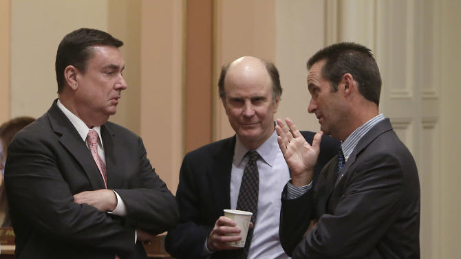 Republican state Senators, Joel Anderson of Alpine, left, Mark Wyland of Escondido, center, and Steve Knight of Palmdale confer as the Senate debated a bill regarding transgender students, at the Capitol in Sacramento, Calif., Wednesday, July 3, 2013. By a 21-9 vote the Senate approved AB1266, by Assemblyman Tom Ammiano, D-San Francisco, that would require public K-12 schools let transgender students choose which restrooms they use and which school teams they join based on their gender identity. Anderson, Wyland and Knight voted against the measure. (AP Photo/Rich Pedroncelli)