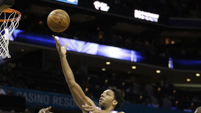 FILE - In this photo taken on Nov. 20, 2015, Philadelphia 76ers' Jahlil Okafor (8) slips through the lane and past a host of Charlotte Hornets as he scores in the second half of an NBA basketball game in Charlotte, N.C. Boston police say they do not plan to investigate an apparent nightclub scuffle involving Okafor unless someone involved comes forward to say they were the victim of a crime. Officer James Kenneally said Friday, NOv. 27, that police responded to reports of a fight outside the nightclub hours after the winless Sixers lost to the Boston Celtics on Wednesday night. But Kenneally says the participants were gone by the time officers arrived and nobody was arrested or charged. (AP Photo/Bob Leverone, File)
