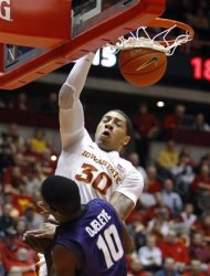 FILE - This Jan. 31, 2012 file photo shows Iowa State forward Royce White (30) dunking over Kansas State forward Victor Ojeleye (10) during the first half of an NCAA college basketball game, in Ames, Iowa. If the decision was based purely on basketball talent, White's name might be one of the first uttered by Commissioner David Stern on June 28. (AP Photo/Charlie Neibergall, File)