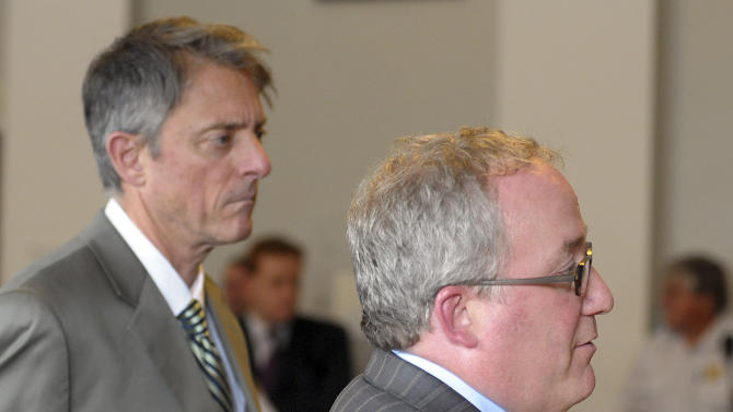 Bristol County District Attorney Sam Sutter, left, stands as Assistant District Attorney Patrick Bomberg speaks during the arraignment of Carlos Ortiz, Friday, June 28, 2013 in Attleboro, Mass. Ortiz was arrested Wednesday in Bristol, Conn., in connection with the murder case against former New England Patriots tight end Aaron Hernandez , now charged in the murder of Odin Lloyd. (AP Photo/The Sun Chronicle, Mark Stockwell, Pool)