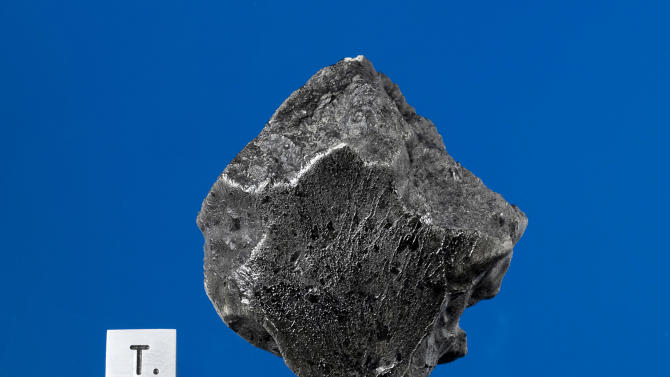 This handout photo provided by Darryl Pitt of the Macovich Collection shows an external view of a Martian meteorite recovered in December 2011 near Foumzgit, Morocco following a meteorite shower believed to have occurred in July 2011. Scientists are confirming a recent and rare invasion from Mars _ meteorite chunks that fell from the red planet over Morocco last summer. Meteorites from Mars are more than 1 million times rarer than gold. And this is only the fifth time experts have chemically confirmed fresh Martian rocks fell to Earth. The last time was in 1962. Scientists believe this meteorite fell last July because there were sightings of it.  (AP Photo/Darryl Pitt, Macovich Collection)