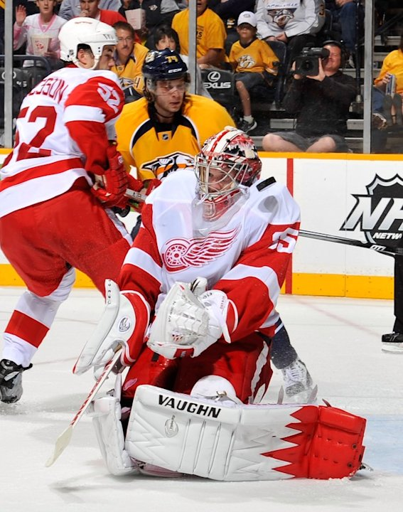 Goalie Jimmy Howard #35 Of The Detroit Red Wings Takes A Puck Off The Shoulder In Game Five Of The Western Conference Getty Images
