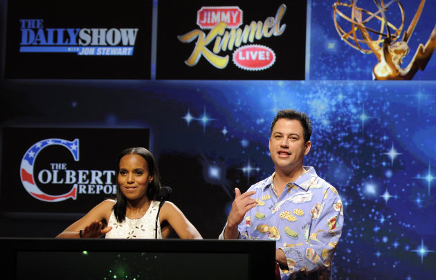 Comedian Jimmy Kimmel, right, reacts alongside fellow presenter Kerry Washington after &quot;Jimmy Kimmel Live!&quot; was nominated for Outstanding Variety Series during the nominations for the 64th Primetime Emmy Awards at the Academy of Television Arts & Sciences in Los Angeles, Thursday, July 19, 2012. The 64th annual Primetime Emmy Awards will be presented Sept. 23 at the Nokia Theatre in Los Angeles, hosted by Kimmel and airing live on ABC. (Photo by Chris Pizzello/Invision/AP)